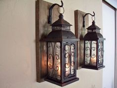 Lantern pair wall decor wall sconces, housewarming gift, bathroom decor, wrought iron hook, rustic wood boards - AllAbout Home! Rustic Lanterns, Hanging Lanterns, Metal Lanterns, Lantern Set, Wall Lantern, Black Lantern, Vintage Wall Sconces, Vintage Walls, Rustic Wall Sconces