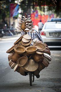 Biking hat and basket seller. #Vietnam