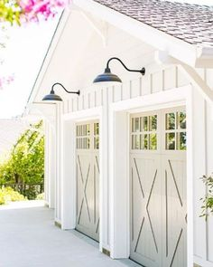 These carriage house garage doors add a soft gray tone to a white garage. These carriage house garage doors add a soft gray tone to a white garage. Notice the garage door windows, x braces, Grey Garage Doors, Carriage House Garage Doors, Garage Door Colors, Garage Door Windows, Best Garage Doors, Garage Door Styles, Garage Door Design, Garage Walls, Garage House