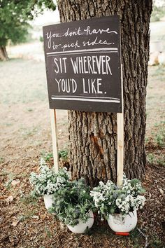 33 Creative Wedding Signs to Bring Personality to Your Big Day: With a dainty lace garland and letters stamped on burlap, this hanging banner is rustic charm at its finest.Source: Encourage families to mingle and get to know one another by putting up a sign for open seating.Source