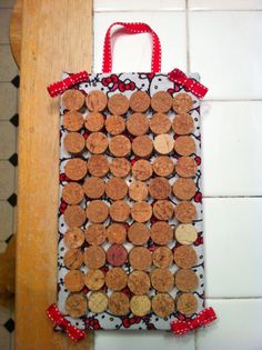 Post earring holder from shoebox lid and wine corks