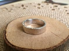This simple band was handmade using sterling silver which I textured, hammered and tumbled for a unique yet classic play on a plain band ring.