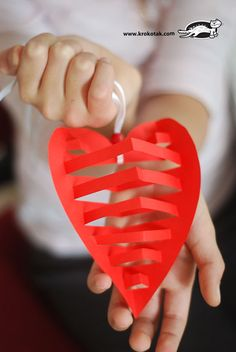 Cut a heart shape out of colored paper and make this 3D ornaments for your love.