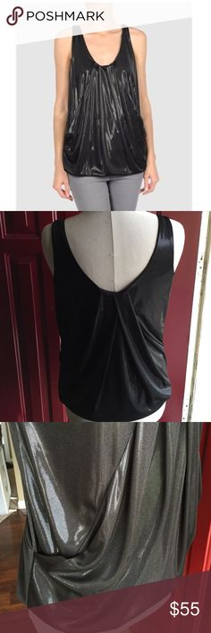 DIANE von Furstenberg top! DVF draped black metallic top! Beautiful like new condition! Fully lined with a soft cotton material! Great with jeans or a pretty skirt! So many options! Size 6. 2 side pockets in the front! 25 inches long. 17.5 inches laying flat across! Second picture is the back! Draped in front and back! Diane von Furstenberg Tops Tank Tops