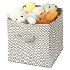 Stow extra throws and pillows with this lovely storage cube, showcasing a chevron motif in taupe.  Product: Storage cube