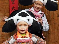 """Miao women, also known as Hmong, are an ethnic minority in China numbering 9.6 million. Within the Miao, the hairstyle of one subgroup has earned them the name """"Long Horns."""""""