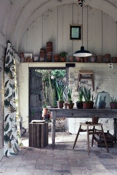 Rustic garden shed with printed curtains, vintage trestle table and pendant light. More garden shed styles at http://www.redonline.co.uk