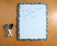 Gems + dry erase board + Command(TM) Picture Hanging Strips + Command(TM) Small Caddy = Dorm Message Board