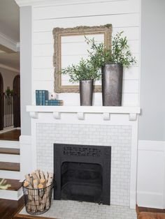 The living room makeover included a restoration of the fireplace with the old green tile replaced with Carrara marble for a timeless look. The shiplap above the mantel was salvaged from walls removed during demolition.