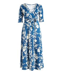 Take a look at this Navy & White Floral Surplice Maxi Dress - Plus today!