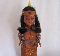 Vintage Knickerbocker Doll Native American Indian - For sale is a vintage Native American doll made by Knickerbocker, probably in the 1950's, on a hear-shaped doll stand. The doll has eyes that close, and is wearing a beaded.