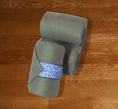 """Equine Polo Wraps/Gray Polo Wraps w/Periwinkle Vines Velcro Strap by KLMequestrian Deck out your horse in style with these gray polos made with quality gray fleece embellished with periwinkle vines fabric on the velcro strap. Made with industrial strength velcro to ensure a proper hold.  Three sizes offered: Pony: 2 yards (6ft) length, 4"""" wide  Horse: 9 ft front, 11 ft hind length, 5"""" wide Extra Long: 4 Yards (12 ft) length, 5"""" wide"""