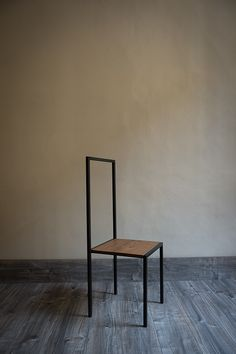 The function of this handmade object is defined by the users: it can just be a seat or can become a bringing clothes or only a piece of interior decoration. MATERIALS: wood and iron