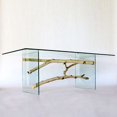 """Resting Branches, dining table in White Birch 1/2"""" rectangular clear tempered glass top, 3/4"""" clear acrylic legs.This may be purchased on ecofirstart.com"""