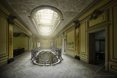 In the center of the Château Lumière, a big light-well lets sunlight pass down through the building to the ground floor. Light Well, The Ch, Urban Exploration, Ground Floor, Urban Decay, Sunlight, Abandoned, Indoor, Explore