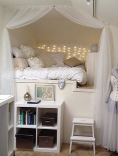 What a lovely small bedroom for a little girl. The bed has become a den, and really calming with simple whites and fairy lights.