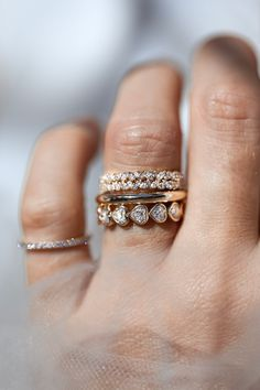 Who says a bridal stack has to be boring? We love this unique and lovely flash of diamonds and gold. Here we have stacks the Double Petite Cluster, Solid Gold Full Round Ring and Abundant Heart Diamond Bezel Eternity Ring. All available in 14k or 18k yellow gold, white gold, rose gold, or platinum.