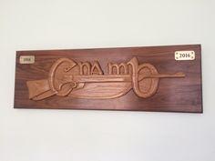 Cuman Na mBann by T. hand carved in walnut & white oak.