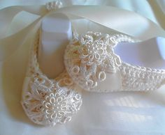"""These booties are made in a beautiful cream Bamboo (80%), Wool (20%) yarn.    Venice lace has been appliqued to the booties  and a gorgeous delicate """"button"""" has been added to make thrm extra special.    Cream satin has been added to the bootie before the applique, so it gives a rich finish.    This set can been used for Christenings etc or just when you feel like dressing baby up."""