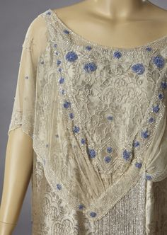 1920s silver lame, silk brocade evening gown covered in silver and blue crystal beads.