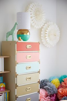 Bright fun colors for Nursery drawers @ohjoy #modernnursery #summerinthecity