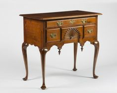 "Queen Anne lowboy in Walnut (not mahogany) from Salem MA Area, 18th C, p.468 (""a mahogany lowboy -- Queen Anne, Salem Massachusetts -- that had been in her mother's familiy since the 1760s."")"