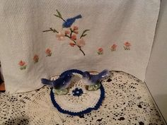 Vintage bluebird embroidery and doily