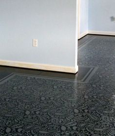 If you have damaged or otherwise less than perfect floors and are on a tight budget, consider painting them with a dramatic eye-catching design like Carrie has done with this amazing painted pattern floor.