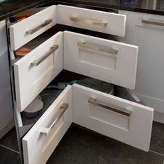 Awkward corner cabinets - nice big drawers for pots and pans and lids!