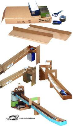 IKEA Schachtel Rennstrecke The post IKEA Karton Rennstrecke appeared first on DIY Projekte. Cardboard City, Cardboard Crafts, Cardboard Race Track, Cardboard Playhouse, Cardboard Castle, Projects For Kids, Diy For Kids, Diy Pour Enfants, Toy Garage