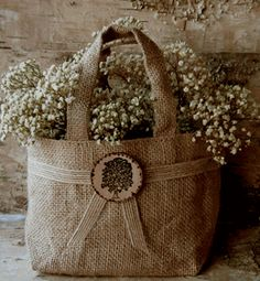 Burlap Flower Girl Basket with Wood Tree Medallion- add baby's breath-how simple and pretty www.save-on-crafts.com