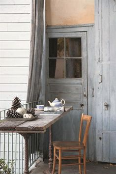 salvaged wood and cast iron | porch sitting area