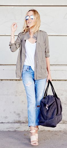 Jacey Duprie is wearing a tote from Lo & Sons Canvas, jeans from J. Crew, military jacket from Soft Joie, tank top from Prima Pocket and shoes from Givenchy