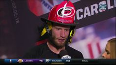 Dec. 19 @ Pittsburgh: Jordan Staal talks to @Meesh_McMahon postgame after getting the #Canes fireman's helmet.