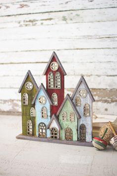 Everyone loves a good Christmas village during the holidays. Set these colorful houses up on your mantle for a unique display and cheery atmosphere this season. Pallet Christmas Tree, Rustic Christmas, Christmas Projects, Holiday Crafts, Diy Arts And Crafts, Fun Crafts, Christmas Centerpieces, Christmas Decorations, Christmas Village Accessories
