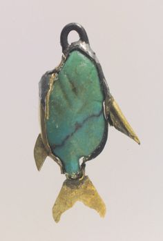 Fish Pendant  Period: Middle Kingdom Dynasty: late Dynasty 12–early Dynasty 13 Date: ca. 1878–1749 B.C. Geography: From Egypt, Memphite Region, Lisht North, cemetery west of Senwosret (758), Pit 847, MMA excavations, 1908–09 Medium: Turquoise, gold Dimensions: L. 2.1 cm (13/16 in.); H. 1 cm (3/8 in.); Th. 0.4 cm (3/16 in.)