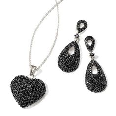 All that glitters is not gold… in this case it is black spinel set in sterling silver. Pave Black Spinel Heart Pendant Necklace in Sterling Silver and Pave Black Spinel Drop Earrings in Sterling Silver, Item no. 860220, 860218