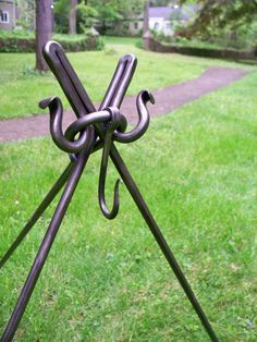 Tripod / Utensil Rack by craftyapple on Etsy- forged steel; three pieces; can use alternate configuration.