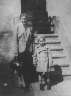 """Gertruda Babilinska with Michael Stolovitzky, a Jewish boy she hid. Yad Vashem recognized her as """"Righteous Among the Nations."""" Vilna, 1943"""