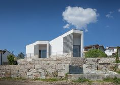 Perforated concrete blocks create patterns of light and shadow inside this mortuary in the Portuguese village of Vila Caiz by architects Raul Sousa Cardoso and Graça Vaz.