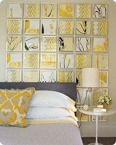 Frame square scrapbook pages in a grid pattern to create an effective accent wall.  Add style and color to any room on a budget.