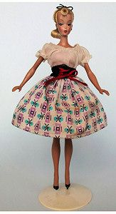 """Bild Lilli sold for a """"buy it now"""" of $ 4,600 and was described by the seller as """"Bild Lilli doll 7.5″ in RARE original Dirndl outfit # 1175 and stand""""."""