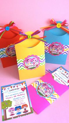 Lalaloopsy invitations. I love the envelopes, would even be cute with store bought invites.