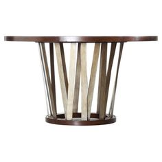 Showcasing an openwork base and a round silhouette, this wood-framed table is perfect for hosting a farm-fresh dinner or Sunday brunch. Hooker joss and Main