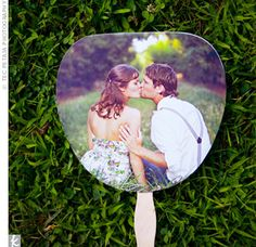 Photo on one side + ceremony program on the other = clever fan for an outdoor wedding.