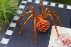 Cute little beaded spider ornament created with the popular burnt orange fall color! Christmas Spider, Gold Christmas Tree, Beautiful Christmas, Christmas Tree Ornaments, Orange Spider, Spider Earrings, Beaded Spiders, Gold Ornaments, Little Pets