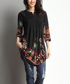 Gentle pin tucks add refined texture to this artistic tunic with a delicate notch neck. The soft and stretchy fabric makes it a quick closet favorite, and it pairs well with slender belts. Note: This is a one-of-a-kind item; prints may vary.