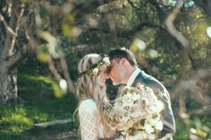 bohemian bride, with giant bouquet and floral garland headband