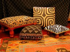 """Donna Klaiman Designs - African Home Decor.  The intricate designs of these traditional cloths have been used for clothing and wrappers for Kings and their wives, as royal tapestries and kneeling mats, for shrouds, status symbols, dowries, and religious vestments. The abstract, symbolic designs greatly influenced early European """"modern"""" artists of last century."""