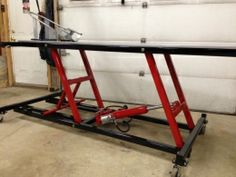 Motorcycle Lift Table - Homemade motorcycle lift table fabricated from steel and powered by a pneumatic cylinder. Caster-mounted for enhanced mobility. Motorcycle Lift Table, Bike Lift, Motorcycle Shop, Motorcycle Wheels, Motorcycle Trailer, Metal Projects, Welding Projects, Homemade Tools, Diy Tools